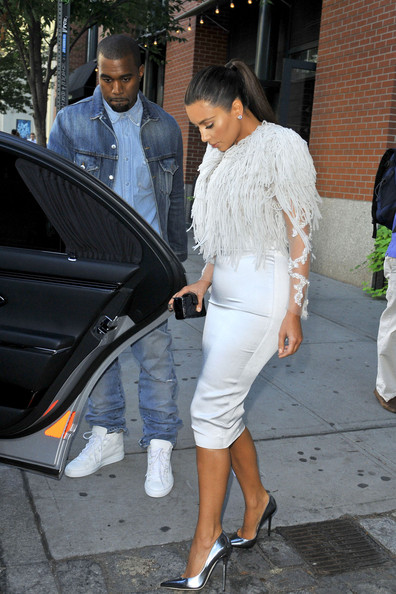 Kim Kardashian and a denim-clad Kanye West arrive at the Marchesa Spring show during New York Fashion Week.