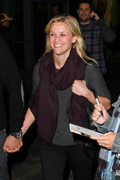 A beaming Reese Witherspoon and her fiance Jim Toth leave the Lakers game in