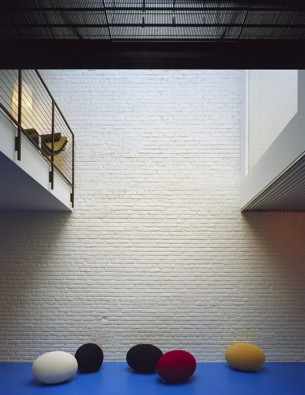 Blue Epoxy Floors Juxtopose Existing White-Painted Brick Walls ©Paul Warchol