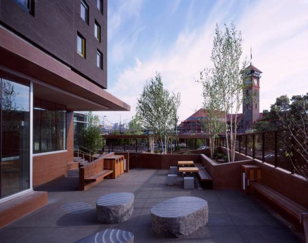 View of public courtyard, with native landscaping, local and durable concrete, and a rainwater collection system. - Photo Credit: Sally Schoolmaster