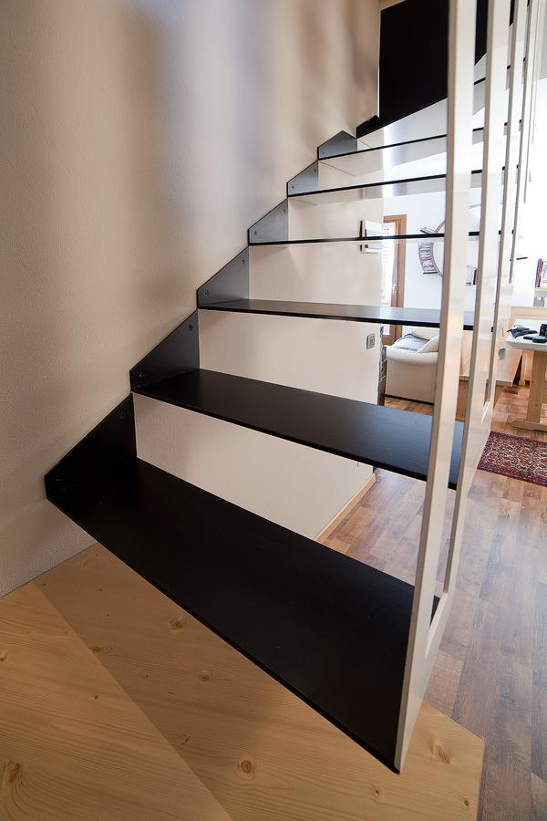 the inside of the stair painted black, in contrast to the white exterior, suggests strong feelings of elegance and sophistication, Image Courtesy © BEAR Progetti