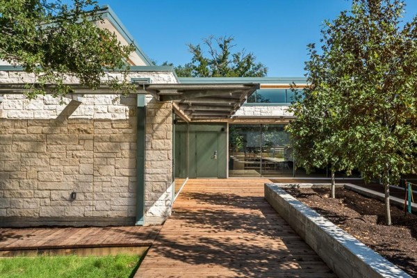 The existing building (not pictured) adjacent to this one is a Texas Hill Country-styled former daycare center.  It has a hipped roof and limestone walls.  The intention is for that building to remain an integral part of the campus, Image Courtesy © Peter Molick Photography
