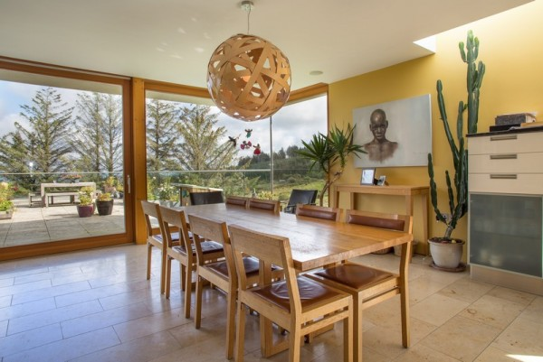 dining area – full-height glazed doors open on to the external dining terrace, Image Courtesy © Paul Tierney