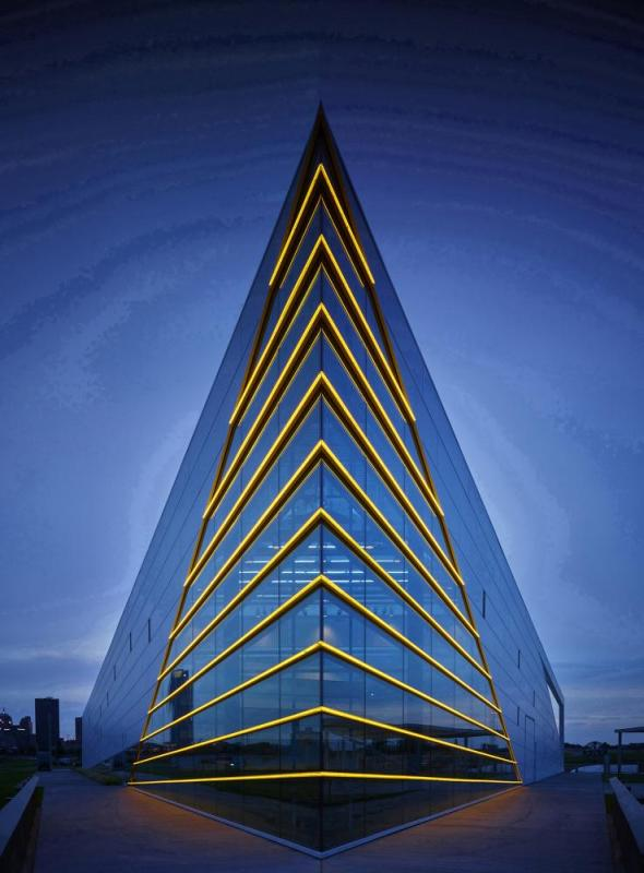 The river side building prow is marked by gold LED lights emphasizing form inspired by a rowing shell.  The concrete platform is within 10' of the river's edge, Image Courtesy © Gray City Studios (Scott McDonald)