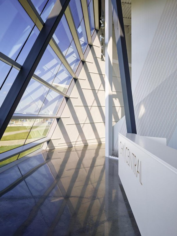 The main lobby has north facing glass. Late afternoon sun creates linear shadows that are referential to rowing, painting, and music (racing lanes, painted lines, and musical instrument strings), Image Courtesy © Gray City Studios (Scott McDonald)
