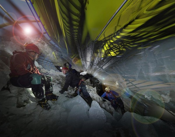 Trekkers tunnel underneath artificial snow cave to enter the structure, Image Courtesy © Margot Krasojević