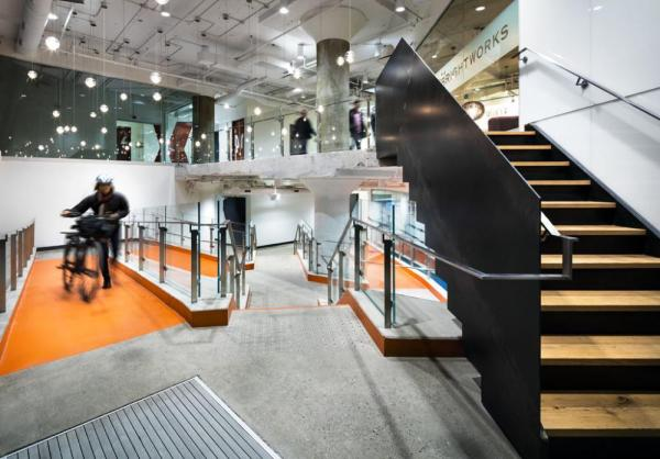 The ground floor was opened up into a dramatic lobby with a series of stairs and ramps, seamlessly integrating accessible design, Image Courtesy © Brandon Barré