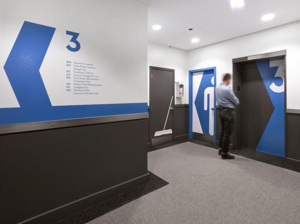 Quadrangle's custom-designed colourful and icon-based wayfinding elements are carried through the building's hallways and shared areas, Image Courtesy © Ben Rahn/A-Frame