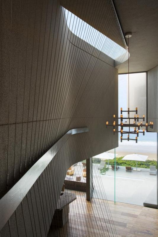 This opening extends vertically through the building, washing northern light through the deeper spaces of the house, Image Courtesy © Adam Letch