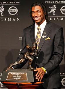 Robert Griffin III with the Heisman Trophy