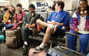 students waiting to get on plane