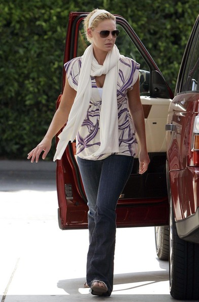 Actress KATHERINE HEIGL wearing a matching white headband and scarf (headbands seem to be popular again), purple geometric pattern blouse and flare jeans while filling up her Land Rover SUV in Los Feliz.
