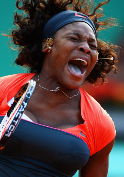 Serena Williams of USA celebrates victory during the Women's First Round match against Klara Zakopalova of Czech Republic on day three of the French Open at Roland Garros on May 26, 2009 in Paris, France.  (Photo by Ryan Pierse/Getty Images) *** Local Caption *** Serena Williams