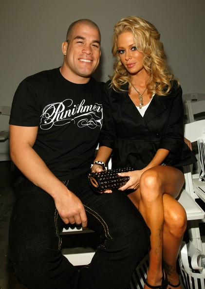 UFC fighter Tito Ortiz and Adult Film Star Jenna Jameson pose  in the front row at the Bow & Arrow by Alan Del Rosario Fall 2008  fashion show during Mercedes-Benz Fashion Week held at Smashbox Studios  on March 11, 2008 in Culver City, California.