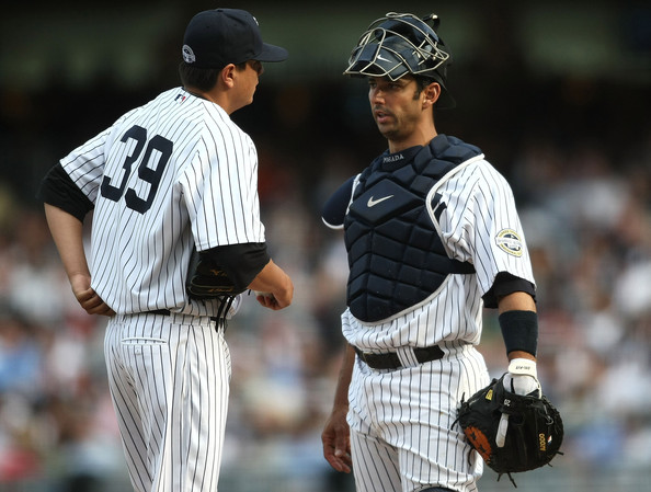 Anthony Claggett #39 of the New York Yankees talks with catcher Jorge Posada #20 against the Cleveland Indians at Yankee Stadium on April 18, 2009 in the Bronx borough of New York City.