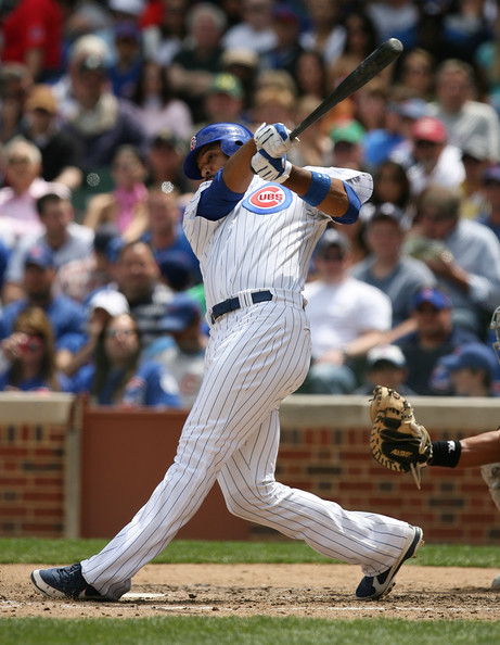 Derrek Lee Derrek Lee #25 of the Chicago Cubs hits his second home run of the season, a solo shot in the 4th inning, against the Florida Marlins on May 2, 2009 at Wrigley Field in Chicago, Illinois. The Cubs defeated the Marlins 6-1. (Photo by Jonathan Daniel/Getty Images) *** Local Caption *** Derrek Lee