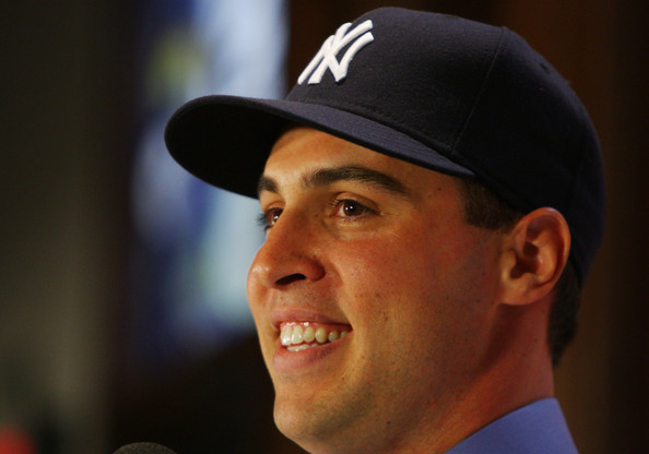 Mark Teixeira talks to the media during a press conference to announce his signing to the New York Yankees at Yankee Stadium on January 6, 2009 in the Bronx borough of New York City.  (Photo by Mike Stobe/Getty Images) *** Local Caption *** Mark Teixeira