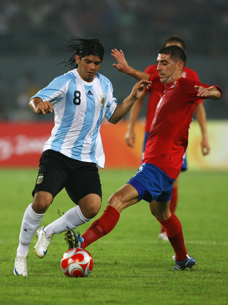 Ever Banega Ever Banega of Argentina battles for a wall with Aleksandar Zivkovic of Serbia during the Men's First Round Group A match between Argentina and Serbia at the Workers' Stadium on Day 5 of the Beijing 2008 Olympic Games on August 13, 2008 in Beijing, China.