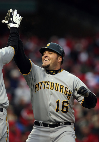 Eric Hinske #16 of the Pittsburgh Pirates is congratulated after he scored in the 9th inning against the St. Louis Cardinals on Opening Day on April 6, 2009  at Busch Stadium in St. Louis, Missouri. The Pittsburgh Pirates defeated the St. Louis Cardinals 6-4.  (Photo by Elsa/Getty Images) *** Local Caption *** Eric Hinske