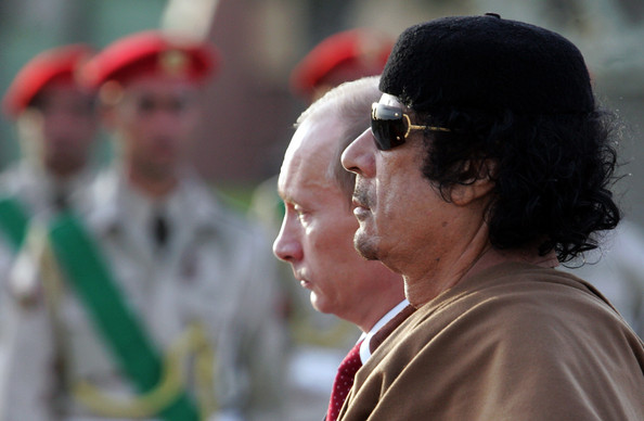 President Vladimir Putin of Russia meets with Libyan leader Muammar Qadaffi on April 16, 2008 In Tripoli, Libya. Putin is in Libya for a two-day official visit to rebuild Russian-Libyan relations.