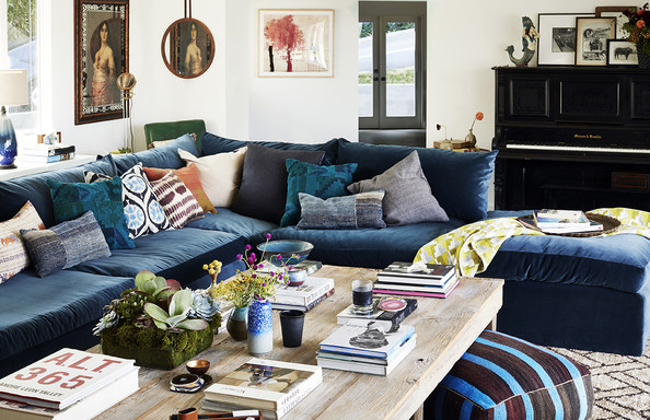 Bohemian Living Room - A living room with an oversized velvet sofa, mixed throw pillows and a rough-hewn coffee table