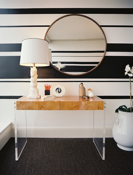 Wall Treatment Modern - Striped walls behind a round mirror and a wooden desk
