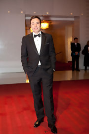Jimmy looks like a gentleman in his black suit and bow tie.