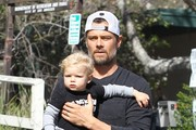 Proud parents Fergie and Josh Duhamel stop to visit a friend's house in Brentwood, California with their son Axl on February 6, 2015. When not spending time with her son and actor husband, Fergie has been hard at work on her second solo studio album, the follow-up to 2006's 'The Dutchess.'