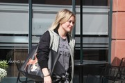 """Younger"" star Hilary Duff is all smiles as she steps out on February 20, 2015 in West Hollywood, California, though she is likely reeling from a recently released story. Hilary's estranged husband Mike Comrie reportedly got drunk and hit on a waitress and patron at Mastro's steakhouse in January. The report goes on to claim he even propositioned a woman, showing her a wad of cash and asking her, ""How much for sex? Name your price."""