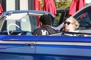 Los Angeles Laker basketball player Nick Young and his rapper girlfriend Iggy Azelea ride in style to grab some Chick-fil-A in Los Angeles, California on December 23, 2014. The happy couple were seen riding in Nick's 1962 Chevy Impala that was a Christmas gift from Iggy!