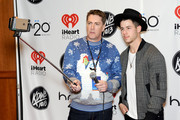 Radio personality Dave Ryan (L) and host Nick Jonas attend 101.3 KDWB's Jingle Ball 2014 presented by Sky Zone Indoor Trampoline Park and Allstate at Xcel Energy Center on December 8, 2014 in St Paul, Minnesota.