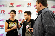 Singer Nick Jonas (C) poses with Fred (R) and Angi (L) from KISSFM at 103.5 KISS FM's Jingle Ball 2014 at Allstate Arena on December 18, 2014 in Chicago, Illinois.