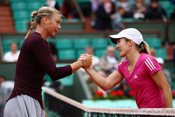 Maria Sharapova Justine Henin of Belgium and Maria Sharapova of Russia shake hands after the women's singles third round match between Justine Henin of Belgium and Maria Sharapova of Russia on day eight of the French Open at Roland Garros on May 30, 2010 in Paris, France.