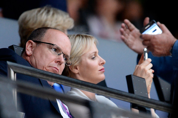 Prince Albert II of Monaco and Princess Charlene of Monaco enjoy the atmosphere during the Opening Ceremony of the London 2012 Olympic Games at the Olympic Stadium on July 27, 2012 in London, England.
