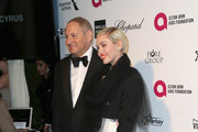 John Demsey, Group President, The Estée Lauder Companies Inc., and singer-songwriter Miley Cyrus attend the 23rd Annual Elton John AIDS Foundation's Oscar Viewing Party on February 22, 2015 in West Hollywood, California.