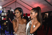 Recording Artists Jhene Aiko and Ariana Grande attend The 57th Annual GRAMMY Awards at the STAPLES Center on February 8, 2015 in Los Angeles, California.