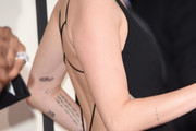Singer Miley Cyrus (tattoo and dress detail) attends The 57th Annual GRAMMY Awards at the STAPLES Center on February 8, 2015 in Los Angeles, California.