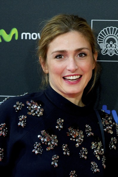 Julie Gayet, French actress,   came to present and promote a Chilean film, Cristian Jimenez's Voice Over, [Director Cristian Jimenez]  which she produced (Producers: Cristian Jimenez, Nadia Turincev, Julie Gayet, Nicolas Comeau) at the Kursaal Palace during the 62nd San Sebastian Film Festival on September 23, 2014 in the northern Spanish Basque city of San Sebastian.   Her production company is Rouge International, with Nadia Turincev.