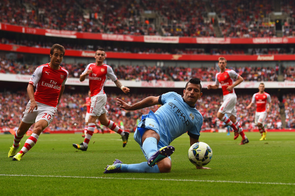 Sergio Aguero of Manchester City stretches for the ball during the Barclays Premier League match between Arsenal and Manchester City at Emirates Stadium on September 13, 2014 in London, England.