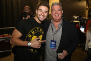 Rapper Jake Miller and Elvis Duran of the Elvis Duran and the Q102 Morning Show pose backstage at the Q102's Jingle Ball 2014 at Wells Fargo Center on December 10, 2014 in Philadelphia, Pennsylvania.