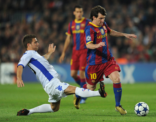 Lionel Messi (R) of Barcelona duels for the ball with Martin Vingaard of FC Copenhagen during the UEFA Champions League group D match between Barcelona and FC Copenhagen at the Camp Nou stadium on October 20, 2010 in Barcelona, Spain.