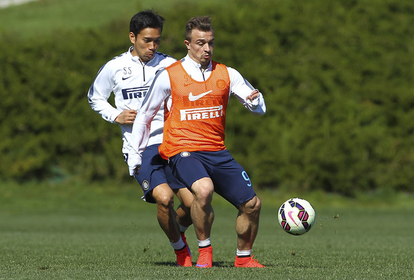 Xherdan Shaqiri (R) competes for the ball with Yuto Nagatomo (L) during FC Internazionale training session at the club's training ground on April 7, 2015 in Appiano Gentile Como, Italy.