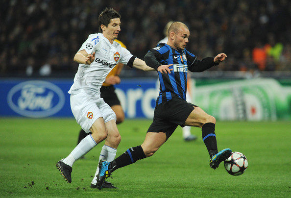 Wesley Sneijder Wesley Sneijder of FC Internazionale Milano is challenged by Aldonin Evgeny of CSKA Moscow during the UEFA Champions League Quarter Finals, First Leg match between FC Internazionale Milano and CSKA Moscow at Giuseppe Meazza Stadium on March 31, 2010 in Milan, Italy.