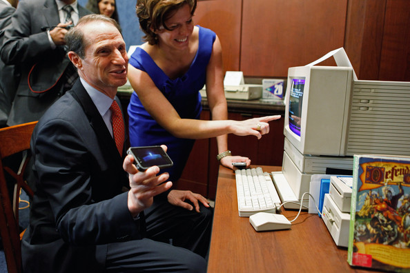 "Jennifer Hoelzer U.S. Sen. Ron Wyden (D-OR) (R) shows off a current version of the computer game ""Oregon Trail"" on his iPhone while playing the the original version on an Apple IIGS with his Communications Director Jennifer Hoelzer (C) after a news conference about the 25th anniversary of the Electronic Communications Privacy Act (ECPA) October 18, 2011 in Washington, DC. Wyden and U.S. Sen. Mark Kirk (R-IL) called for the ECPA legislation to be updated so to ensure that the government must get a warrant from a judge before tracking our movements or reading our private communications."