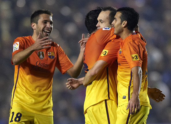 Andres Iniesta (2-r) of Barcelona celebrates scoring with his teammate Pedro Rodriguez (R), Jordi Alba (L) and Xavi Hernandez during the la Liga match between Levante UD and FC Barcelona at Ciutat de Valencia on November 25, 2012 in Valencia, Spain.