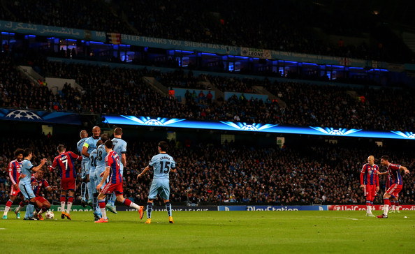 Xabi Alonso of Bayern Muenchen levels the scores at 1-1 as he scores a goal with a free kick during the UEFA Champions League Group E match between Manchester City and FC Bayern Muenchen at the Etihad Stadium on November 25, 2014 in Manchester, United Kingdom.