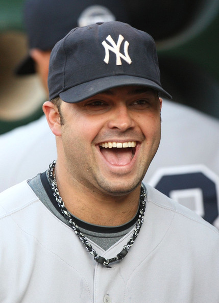 Nick Swisher #33 of the New York Yankees smiles in the dugout prior to the Major League Baseball game against the Oakland Athletics at the Oakland Coliseum on August 17, 2009 in Oakland, California.