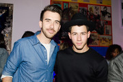 Nick Jonas (R) poses for a photo during his Pop Up Performance at Peter Tunney Gallery on September 10, 2014 in New York City.