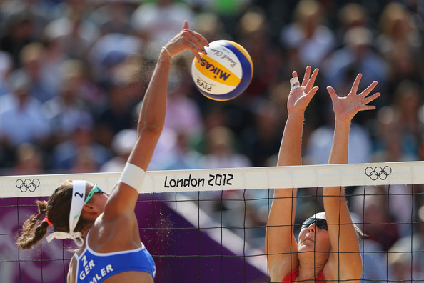 Ilka Semmler of Germany jumps for a spike against Hana Klapalova of Cyech Republic during the Women's Beach Volleyball match between Germany and Czech Republic on Day 1 of the London 2012 Olympic Games at Horse Guards Parade on July 28, 2012 in London, England.