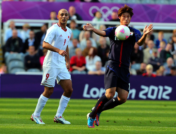 Hotaru Yamaguchi of Japan controls the ball against Nourreddine Amrabat of Morocco during the Men's Football first round Group D match between Japan and Morocco on Day 2 of the London 2012 Olympic Games  at St James' Park on July 29, 2012 in Newcastle upon Tyne, England.